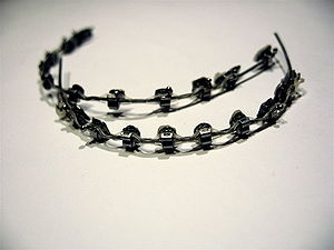 Dental braces, with a powerchain, removed afte...