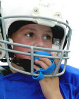 Head guard with attached mouth guard to minimise injury