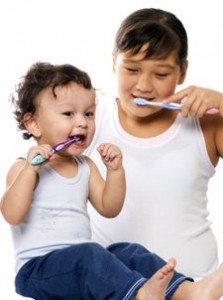 children brushing 223x300 Dental Sealants Vs. Fillings in Pediatric Dentistry