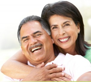 2a couplesmiling 300x270 How Aging Affects Our Mouth
